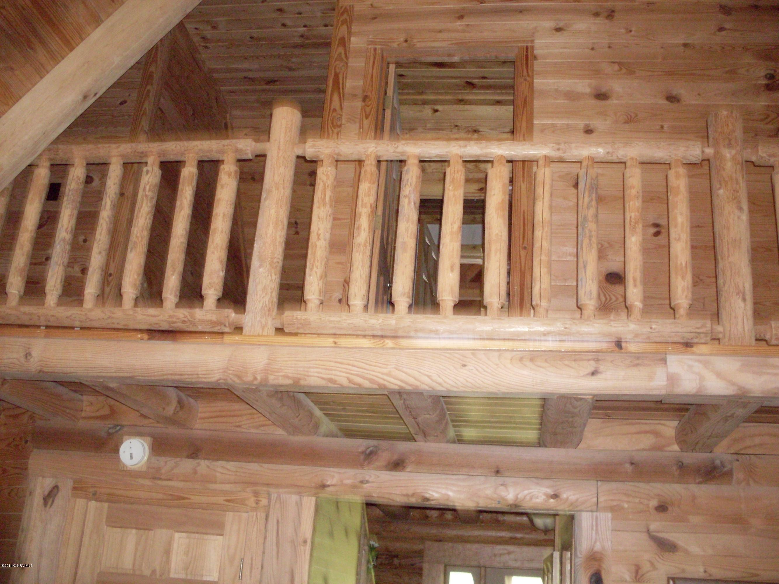 awesome interior design of Southland Log Homes in double tier design with railing and wooden door ideas