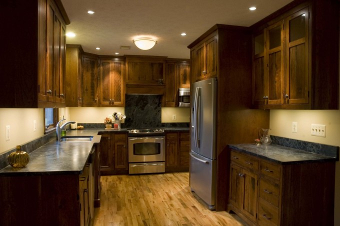 Awesome Kitchen American Woodmark Cabinets In Natural Color With Granite Countertop And Stove Plus Fridge On Wooden Floor For Kitchen Decor Ideas
