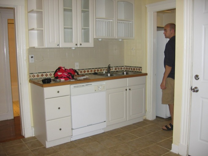 Awesome Kitchen American Woodmark Cabinets In White With Brown Countertop And Sink Plus Faucet For Kitchen Decor Ideas