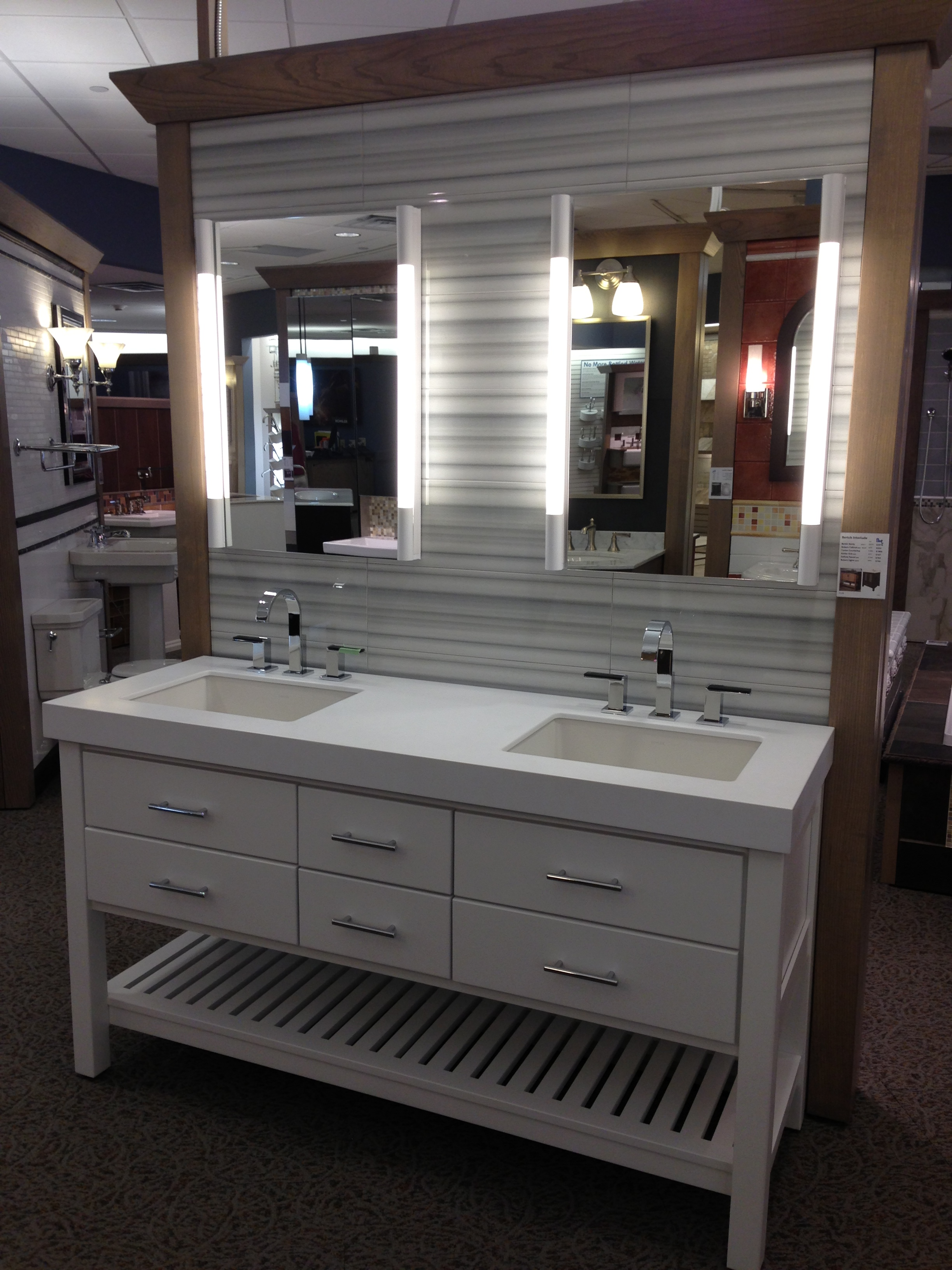 awesome laminate bathroom bertch cabinets in white with double sinks and faucets plus hutch with double mirrors for bathroom furniture ideas