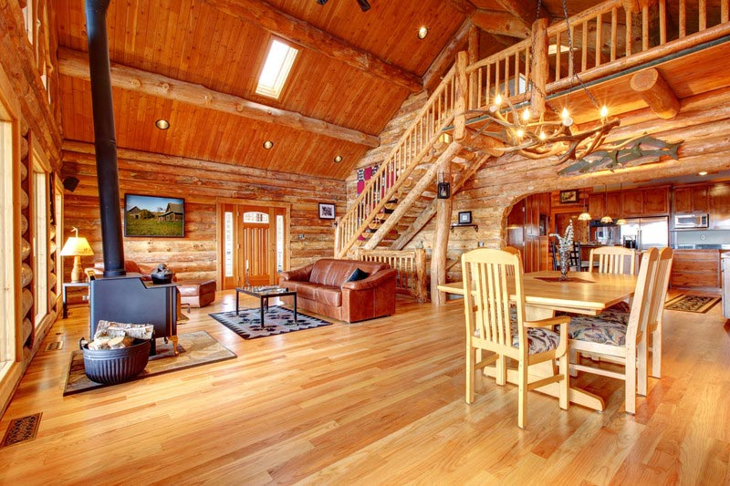 awesome living room design of Southland Log Homes with dining table set and sofa set plus fireplace ideas