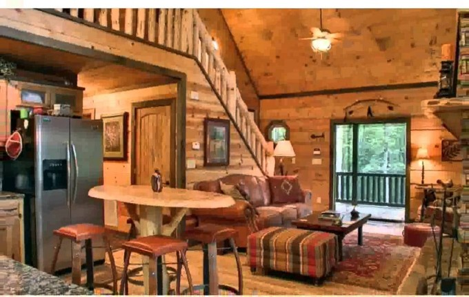 Awesome Living Room Design Of Southland Log Homes With Sofa Set And Ottoman On Floral Rug Plus Fan Ceiling With Light Ideas