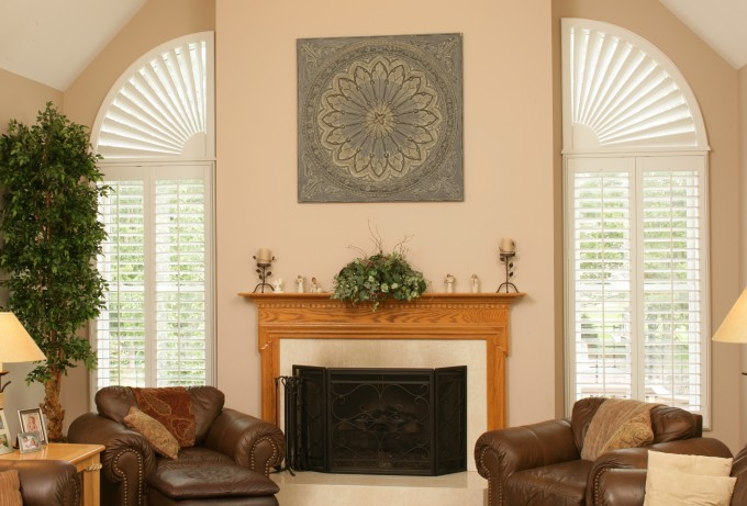Awesome Sunburst Shutters With Arc In Half Matched On Beige Plus Fireplace And Brown Leather Sofa For Home Interior Design Ideas