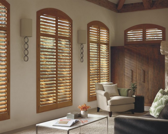 Awesome Sunburst Shutters With Curved At Top Matched On White Wall With Wall Sconce For Home Interior Design Ideas