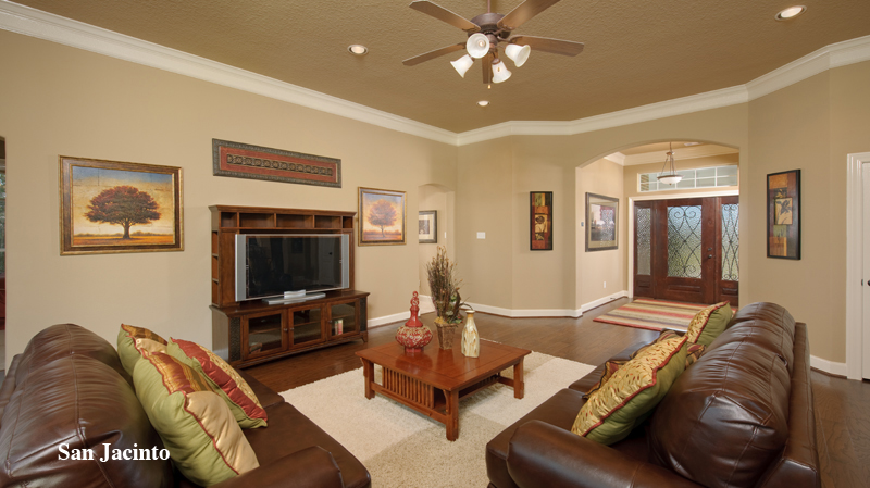 awesome tilson homes living room design with cream wall matched with wooden floor plus large television ideas