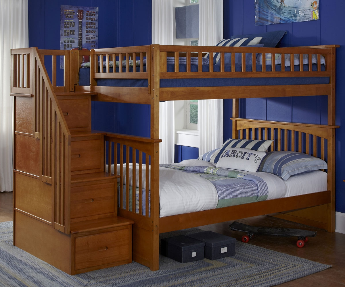 awesome wood Bunk Beds With Stairs and storage before the blue wall matched with wooden floor with rug for teens bedroom decor ideas