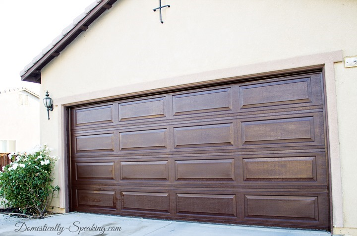 awesome wooden garage door using minwax gel stain matched with white siding for exterior design ideas