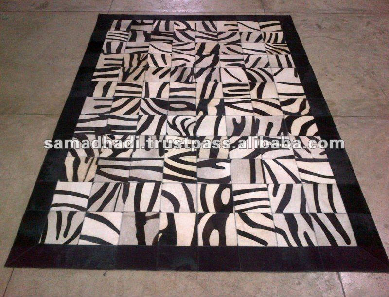 beautiful cowhide patchwork rug in black and white with zebra motif for floor decor ideas