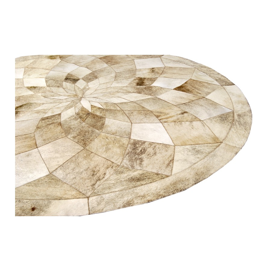 beautiful cowhide patchwork rug in creamy white with circle diamond motif for floor decor ideas
