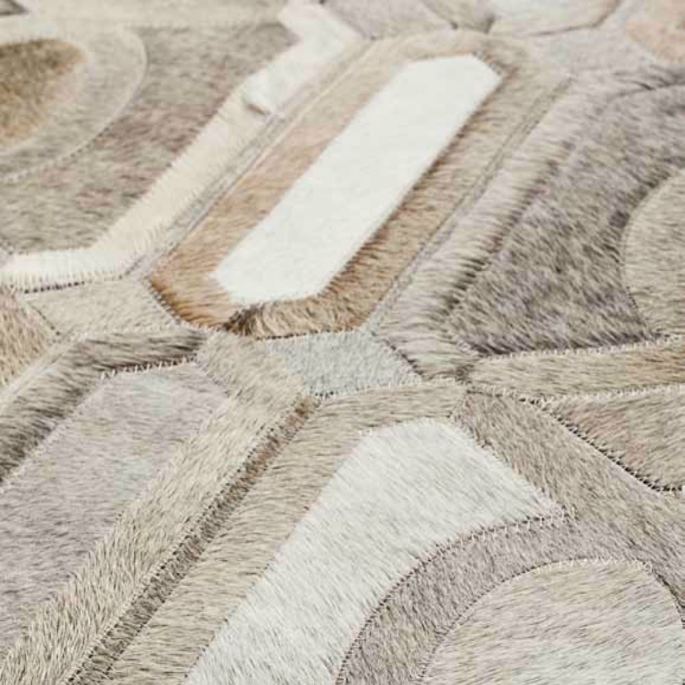beautiful cowhide patchwork rug in creamy white with diamond motif for floor decor ideas