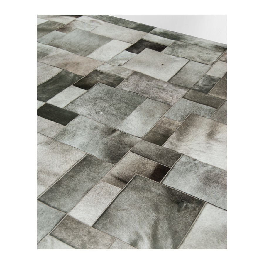 beautiful cowhide patchwork rug in grey with puzzle motif for floor decor ideas