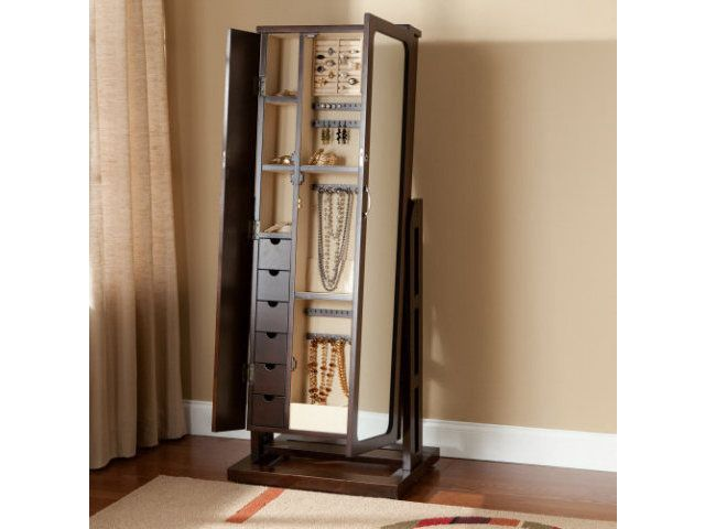 Beautiful Wooden Standing Mirror Jewelry Armoire In Black On Wooden Floor Before The Burly Wood Wall For Living Room Decor Ideas