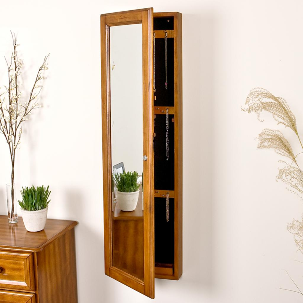 beautiful wooden standing mirror jewelry armoire in golden brown before the white wall plus golden brown table for living room decor ideas