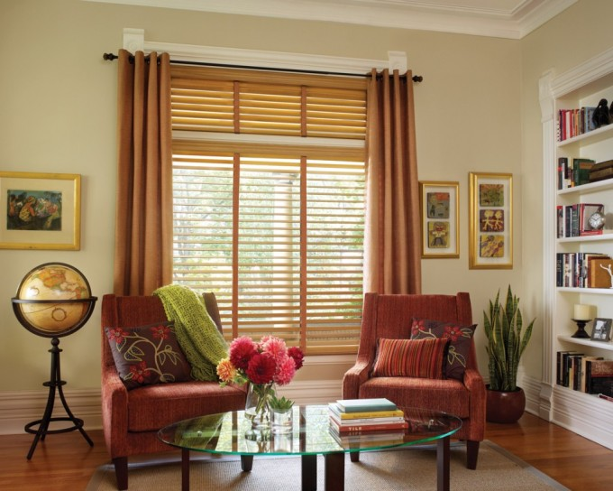 Beige Wall With Window And Brown Faux Wood Blinds Plus Brown Curtain Matched With Wooden Floor Plus Sofa And Round Glass Table For Living Room Decor Ideas