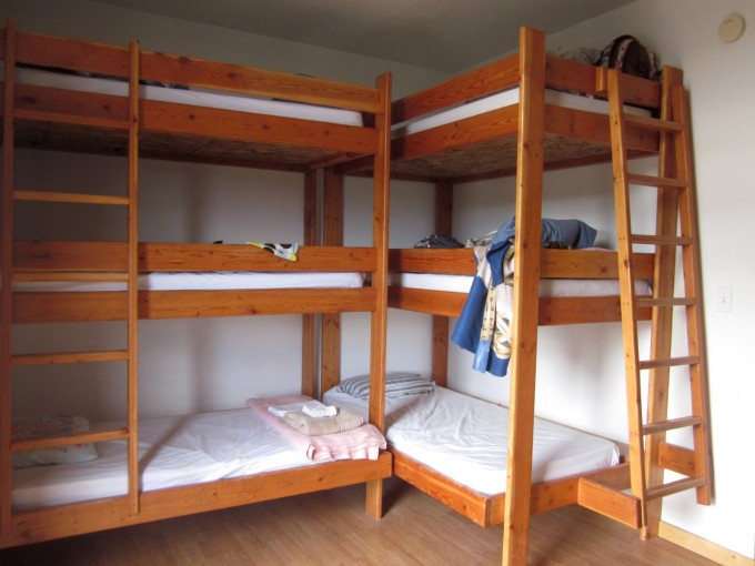 Brown Wooden Bunk Beds With Stairs Having White Bedding Set Placed On Wooden Floor Matched With White Wall And White Ceiling For Teen Bedroom Decor Ideas