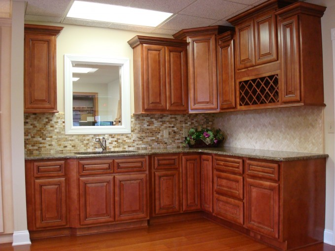 Brown Wooden Kitchen Cabinet With Countertop And Mosaic Tile Backspash On Konecto Wooden Floor For Kitchen Decor Ideas