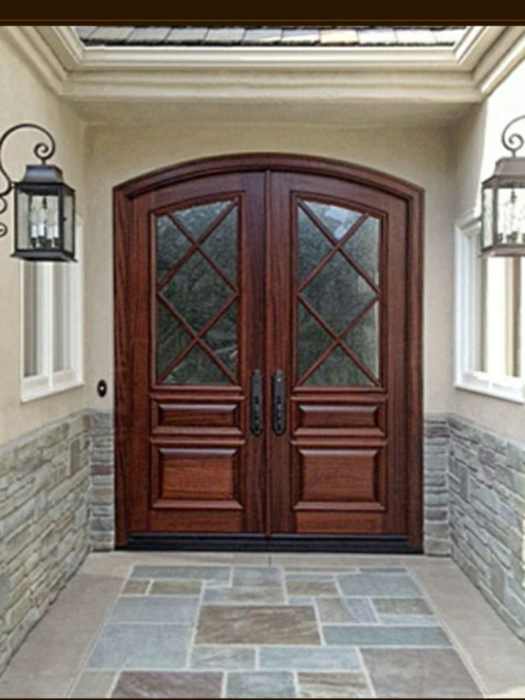 charming brown wooden door using minwax gel stain matched with cream wall and stone veneer wainscoting for home exterior design ideas