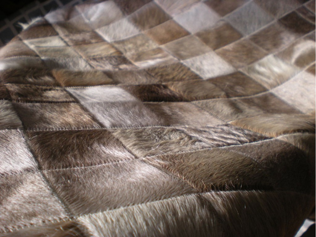 charming cowhide patchwork rug in brown with checked motif for floor decor ideas