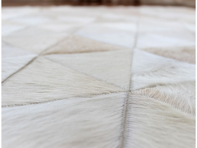Charming Cowhide Patchwork Rug In Creamy White With Triangles Shape Inside For Floor Decor Ideas