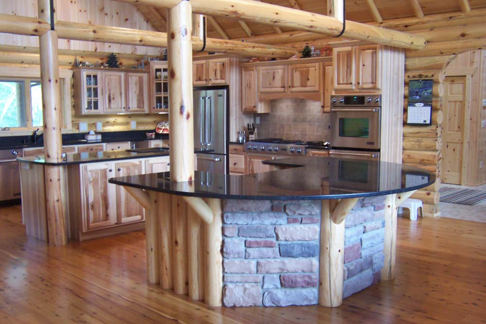 charming kitchen design of Southland Log Homes with kitchen island and countertop plus stove and fridge ideas