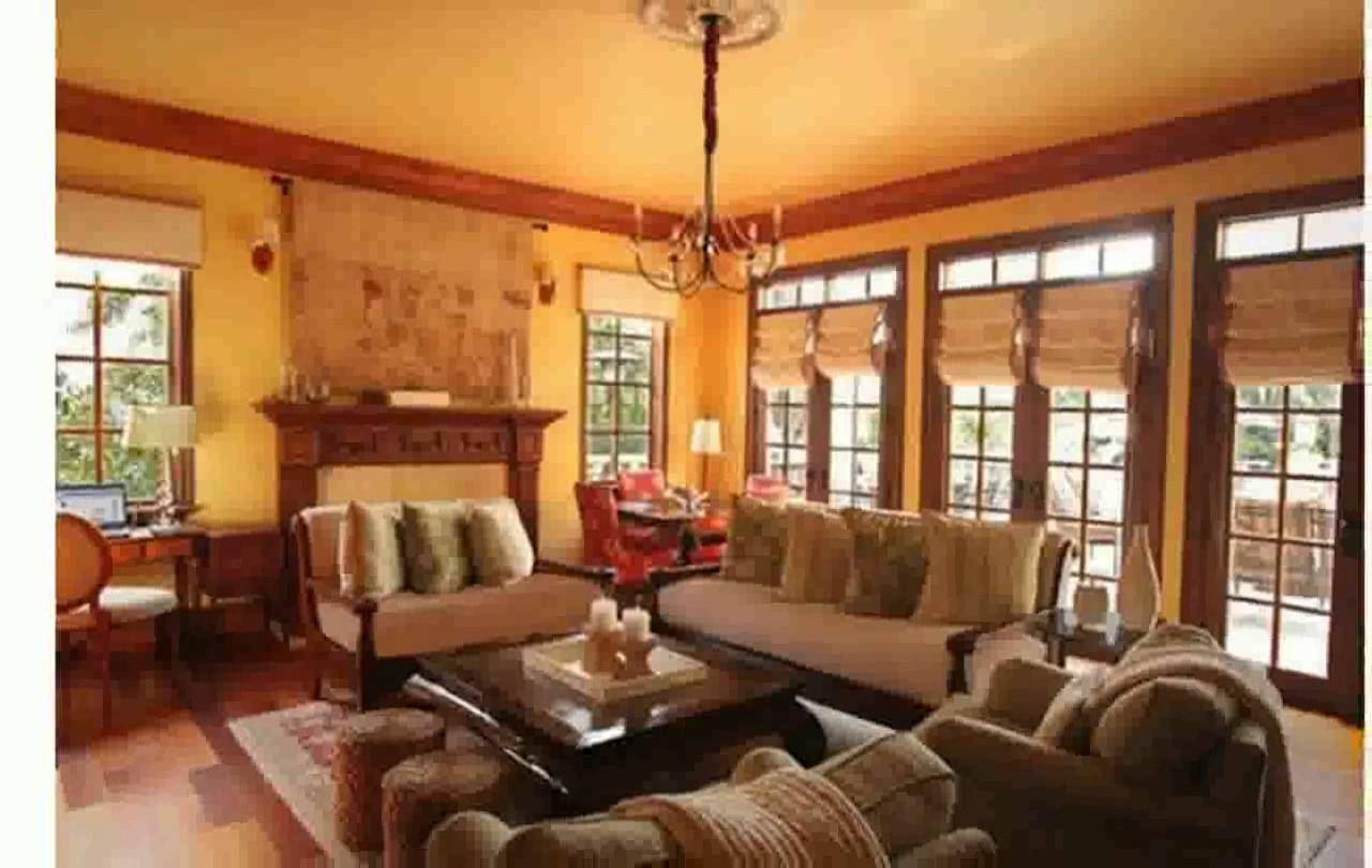 charming living room design of Southland Log Homes with sofa set and square table on floral rug plus chandelier ideas