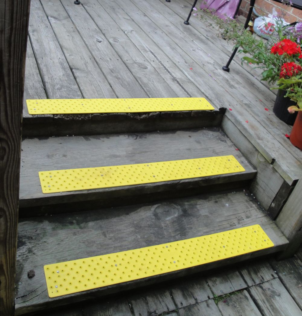 charming non slip stair treads in yellow on wooden stepping stair matched with wooden deck for home exterior ideas