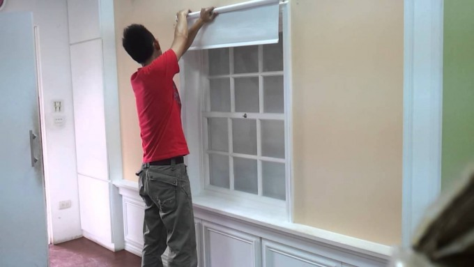 Charming Single Hung Window With White Levolor Cellular Shades On Cream Wall With Decorative Wainscoting For Home Interior Design Ideas