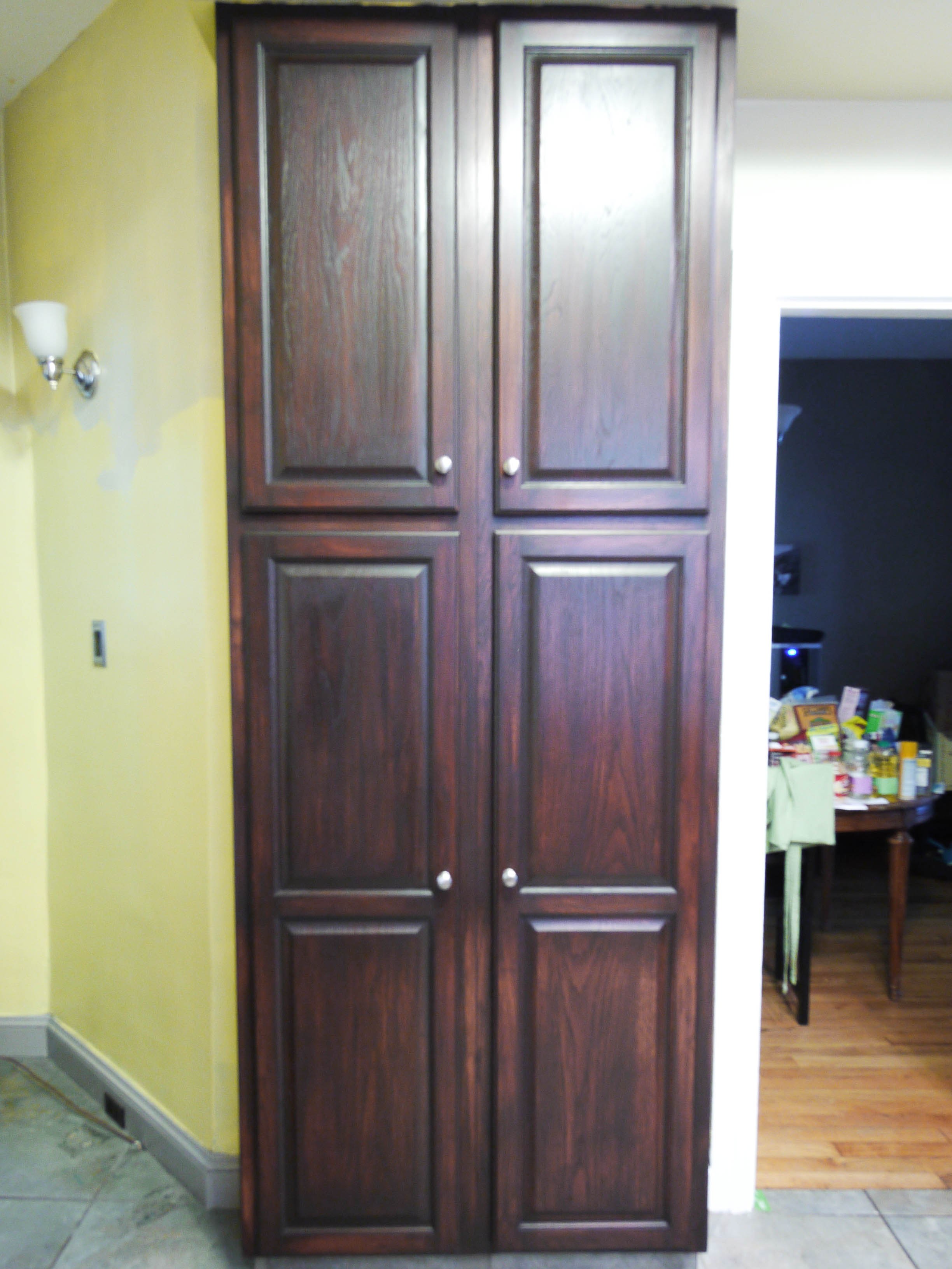 charming tall wooden cabinet using minwax gel stain before the green wall with light for home design ideas