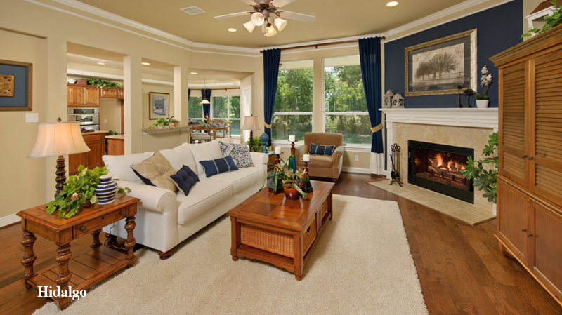charming tilson homes living room design with white sofa and wooden table plus white rug on wooden floor plus blue curtain and fireplace ideas