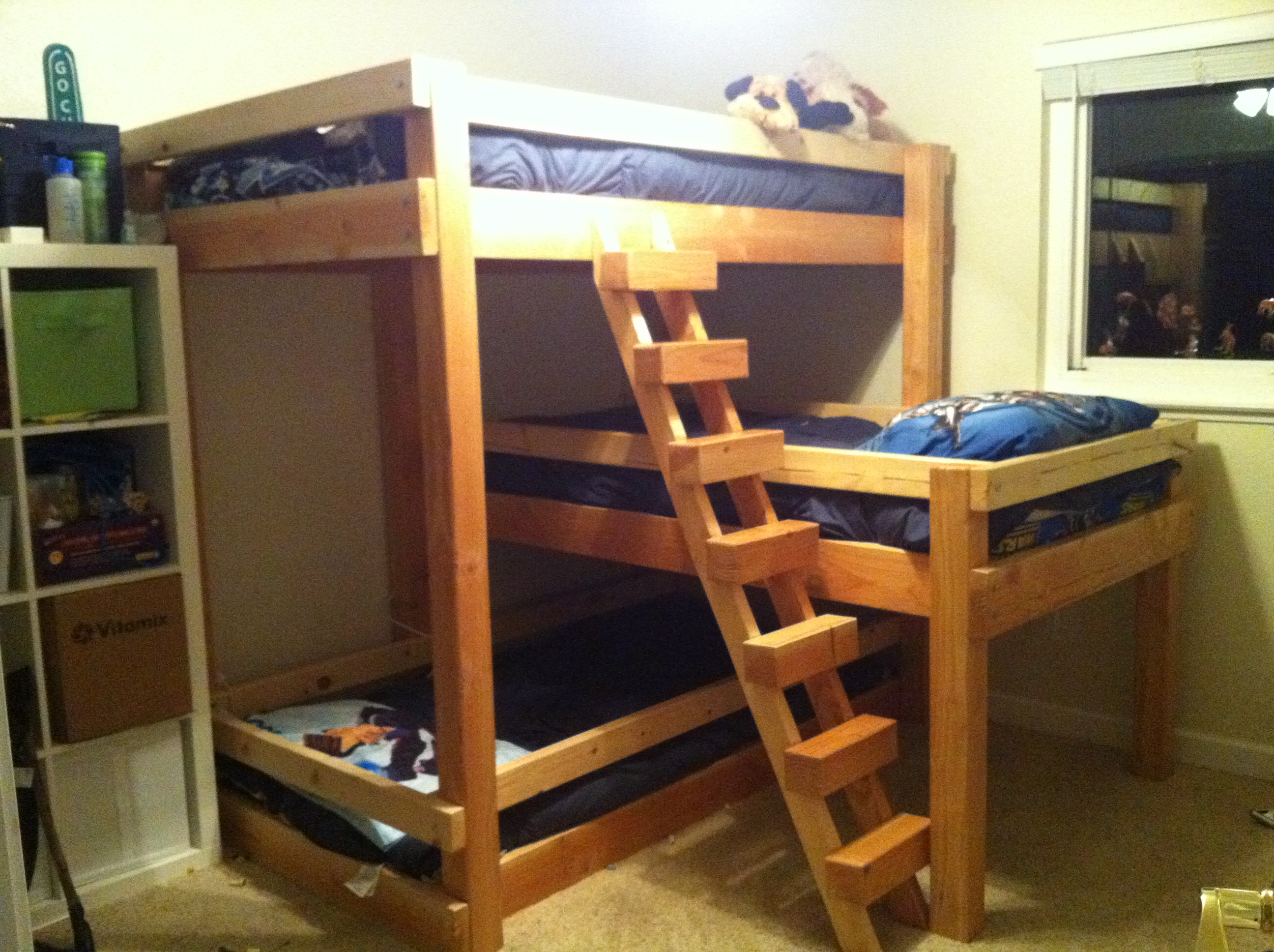 charming wood Bunk Beds With Stairs and blue bedding before the cream wall matched with beige floor for teen bedroom decor ideas