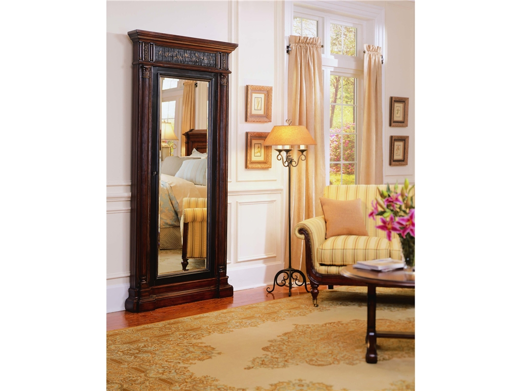 charming wooden standing mirror jewelry armoire in brown before the white wall with wainscoting matched with wooden floor with cream rug plus sofa for living room decor