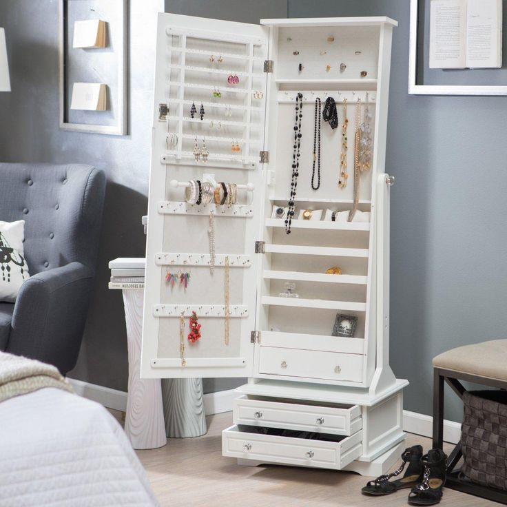 charming wooden standing mirror jewelry armoire in white with double drawers at bottom before the gray wall matched with wooden floor plus sofa for living room decor ideas