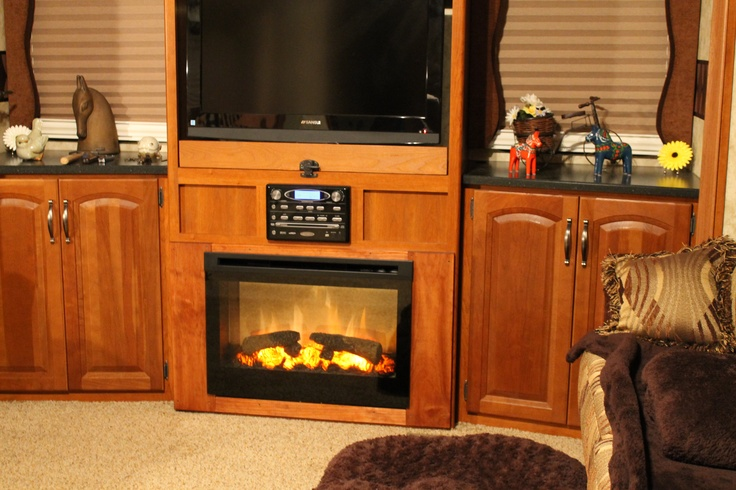 chic black dimplex electric fireplaces on sandy brown wood buffet with tv stand and black top for family room ideas