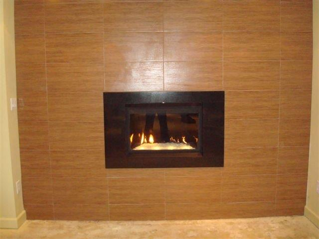 chic black framed napoleon fireplace on brown wall for heatwarming room decor ideas
