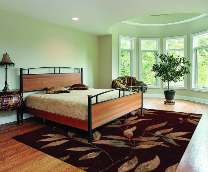 Chic Brown Dalyn Rugs With Leaves Motif On Wooden Floor Matched With Green Wall Plus Bed For Bedroom Decor Ideas