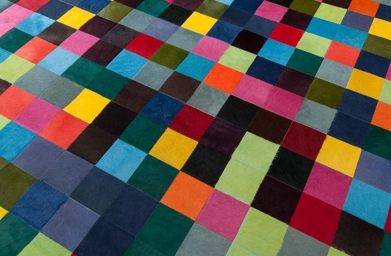 chic cowhide patchwork rug in colorful design with checked motif for floor decor ideas