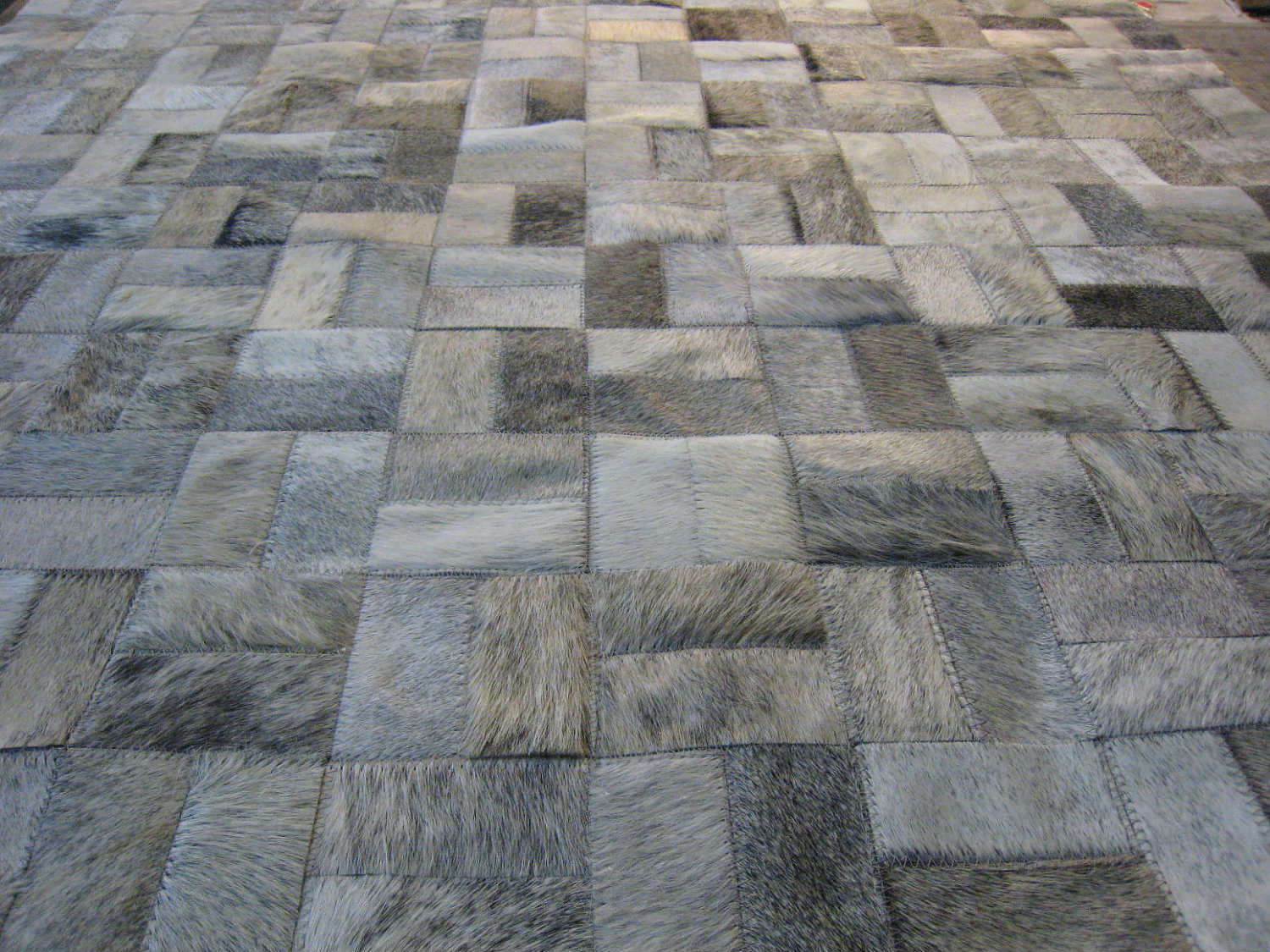 chic cowhide patchwork rug in grey with puzzle motif for floor decor ideas