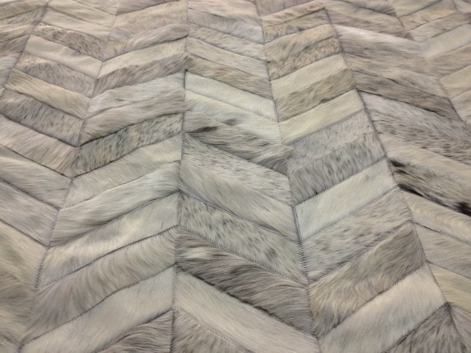 chic cowhide patchwork rug in grey with zigzag motif for floor decor ideas