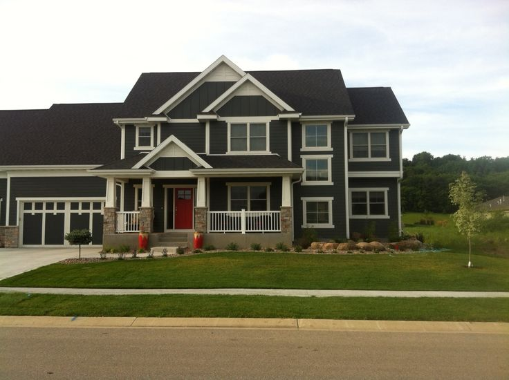 chic dark horizontal hardie plank siding with white trim board and glass window for home exterior design