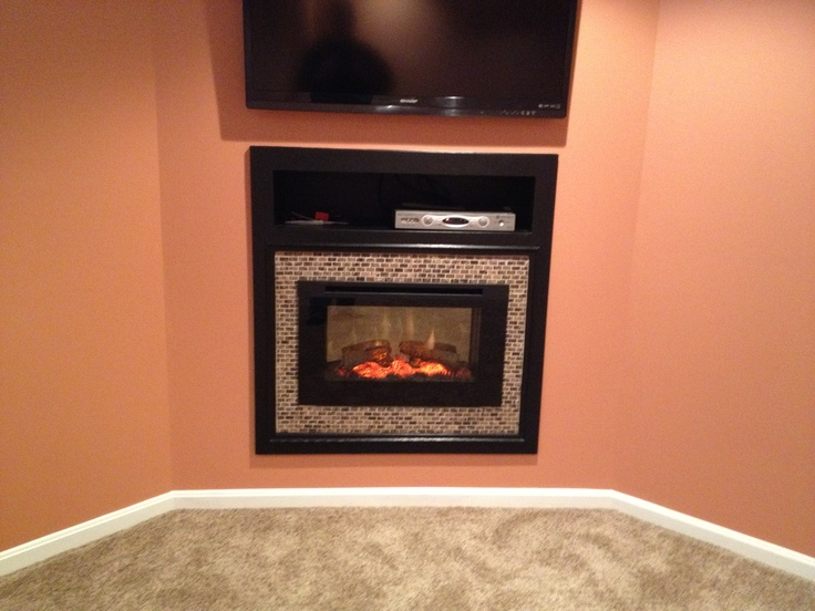 chic dimplex electric fireplaces on orange wall with tv matched with beige rug for family room decor ideas