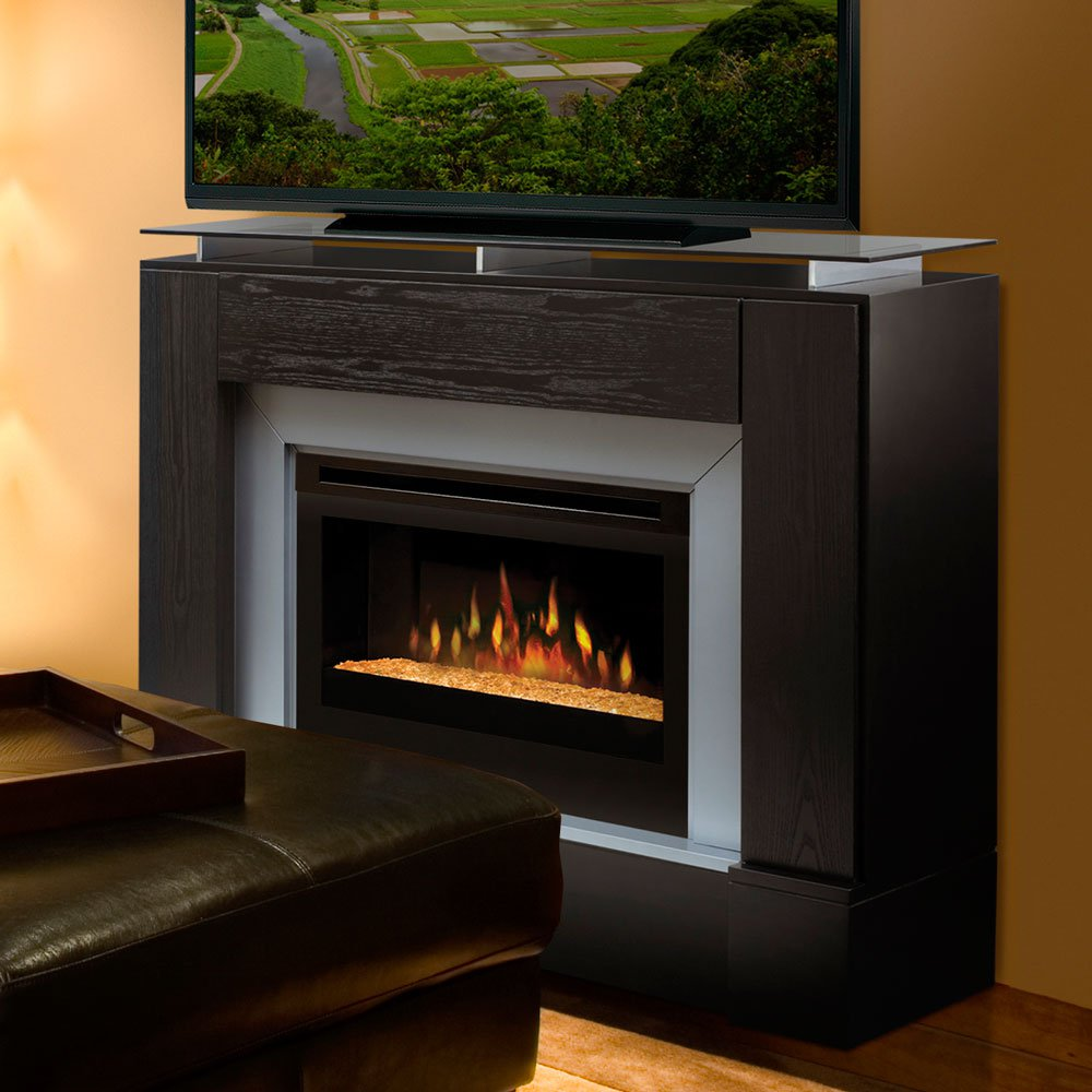 chic dimplex electric fireplaces with black mantel kit under the television before the orange wall matched with wooden floor plus leather ottoman for family room decor ideas