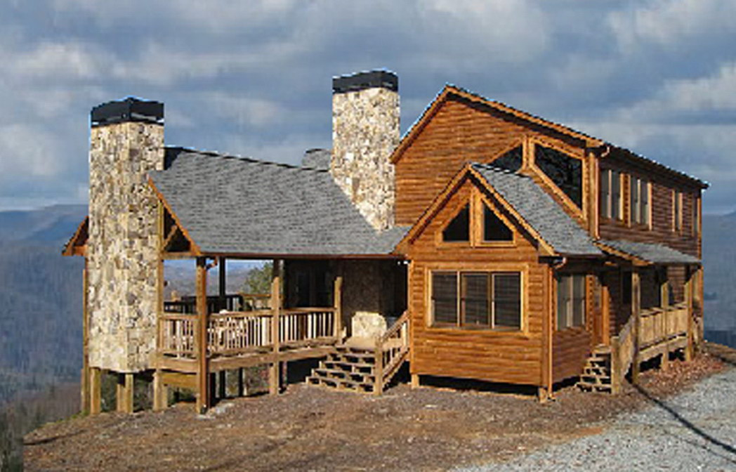 chic exterior design of Southland Log Homes with chimney and railing plus single hung windows ideas