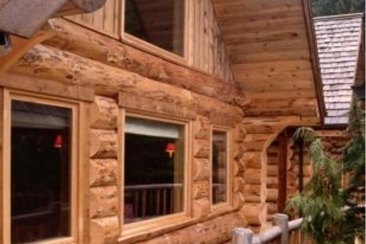 chic exterior design of Southland Log Homes with glass windows and railing ideas