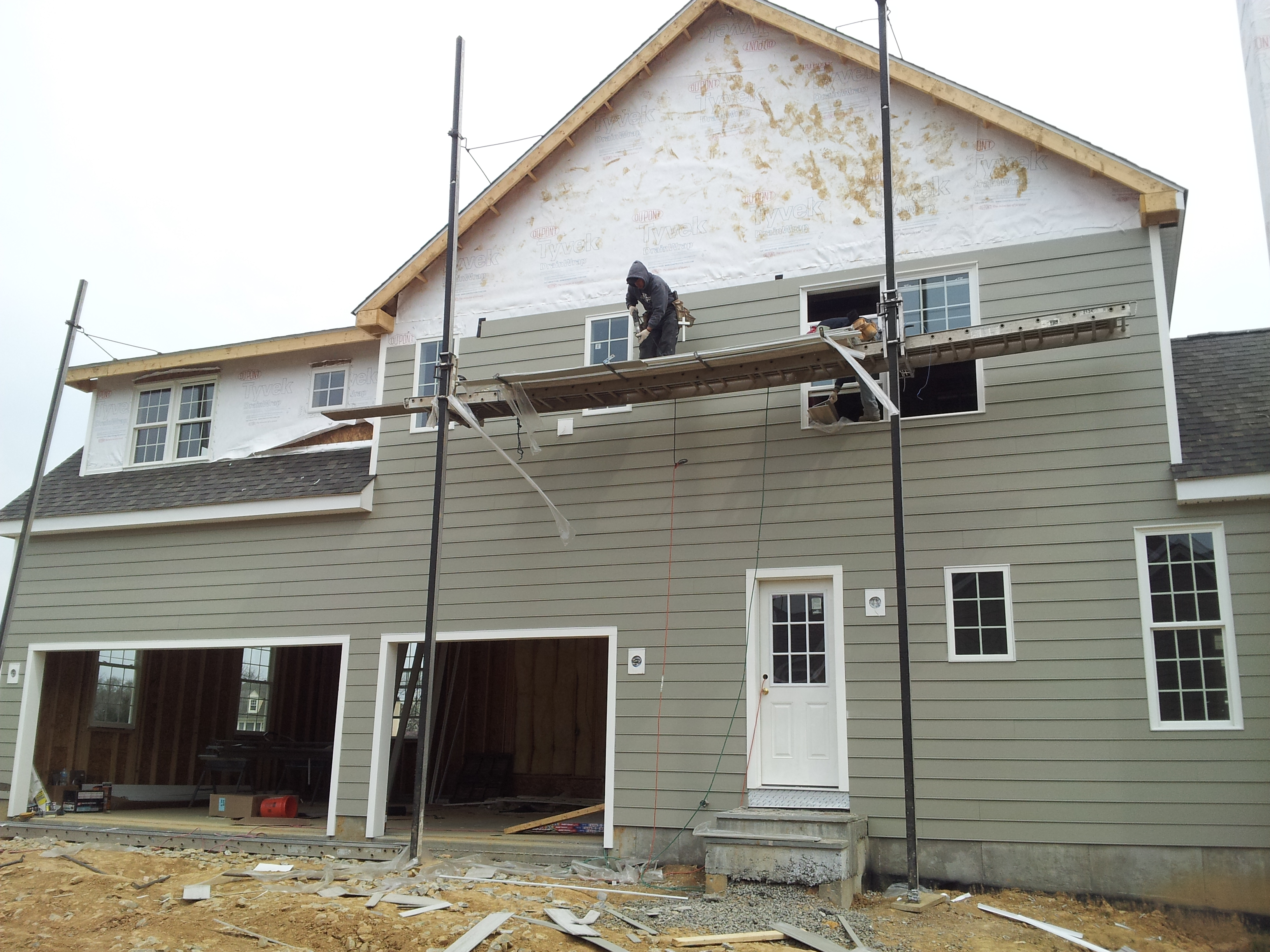 chic gray hardie plank siding matched with whte trim board and white door plus window for home exterior design ideas