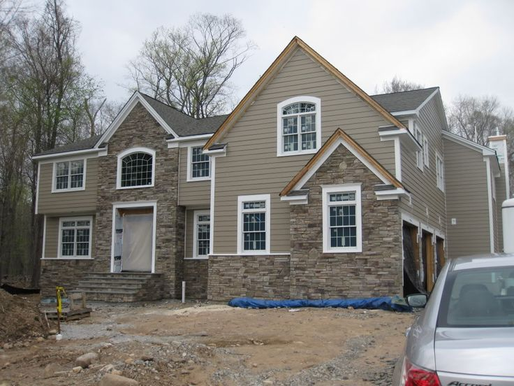 chic horizontal hardie plank siding in beige with white trim board and natural stone siding for home exterior design ideas