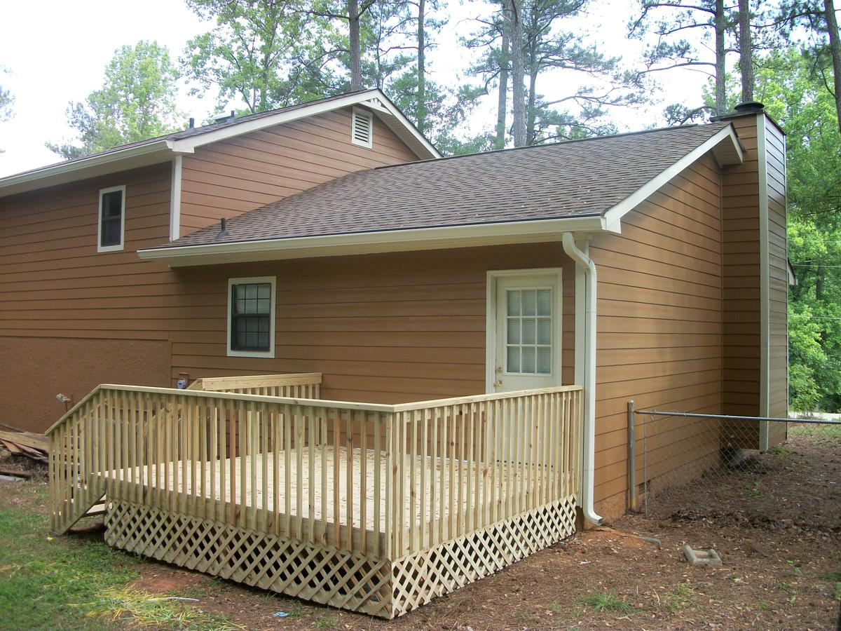 chic horizontal hardie plank siding in brown with white trim board and cream railing for home exterior design ideas