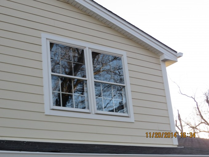 Chic Horizontal Hardie Plank Siding In Cream With Single Hung Window For Home Exterior Design