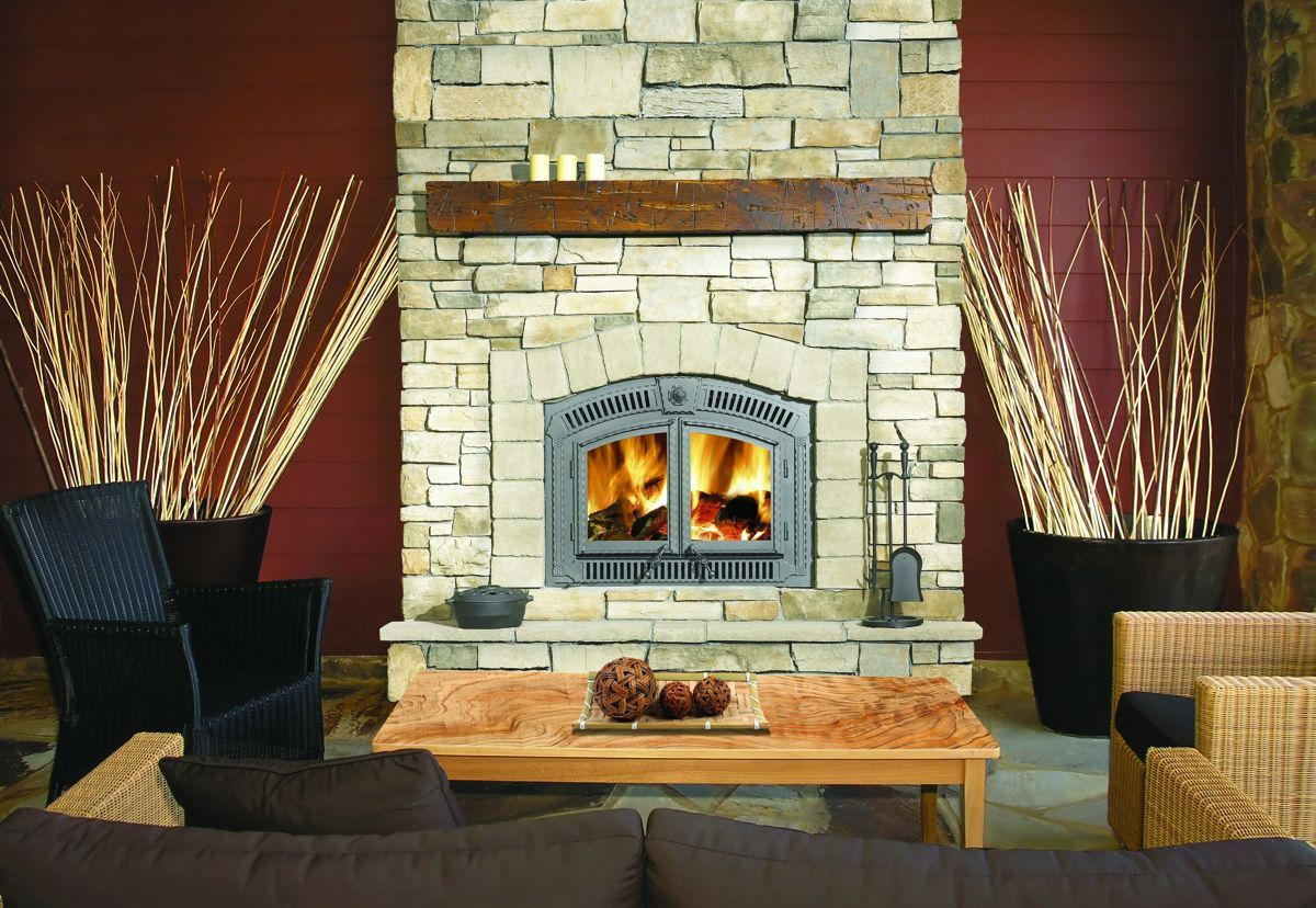 chic napoleon fireplace with natural stone mantel kit matched with red wall plus brown sofa for family room decor ideas