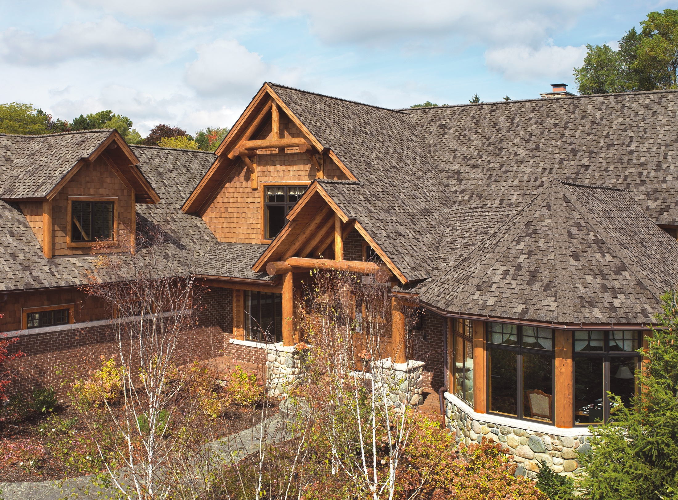 chic traditional home exterior design using dark gaf timberline hd roof matched with brick siding ideas
