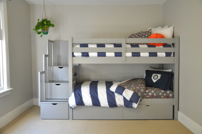 chic wood Bunk Beds With Stairs in gray with drawers on beige floor matched with gray wall for teen bedroom decor ideas